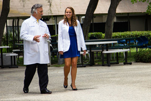 New UC Irvine medical student Brianna Miner chats with Dr. Manuel Porto, who delivered her and her three siblings at UC Irvine Medical Center two decades ago.