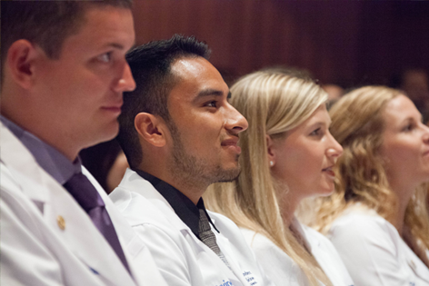 Oscar Hernandez (second from left) attends the UC Irvine School of Medicine's 2015 White Coat Ceremony for incoming students.
