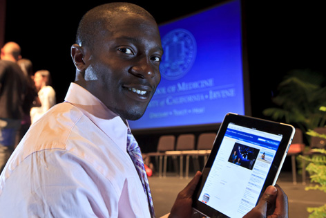 Folu Ani, a member of the Class of 2014 at UC Irvine School of Medicine, holds an iPad pre-loaded with his first-year curriculum.