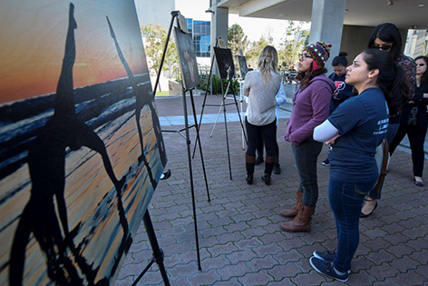 UC Irvine medical students attend an exhibit of fellow students' art work, created as part of the School of Medicine's effort to incorporate the humanities and arts into its programs.
